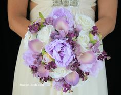 Wedding bouquet with wisteria calla lilies, wisteria delphinium and plum lilacs.  Matches Davids Bridal Wisteria bridesmaids dresses perfectly