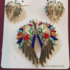 """Angel Wings silver tone pendant / pierced Earrings Angel wings pendant and pierced earrings multi colored in silver tone.  Never been worn.  Pendant is approximately 2"""" tall x  1  3/4"""" wide.  Earrings approx 1"""" tall x 3/4"""" wide Jewelry Earrings"""