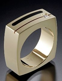 14kt yellow gold design with inlaid black jade and princess cut diamond (approximately 0.15 carats)