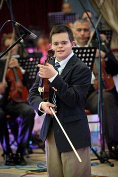 Talented and Inspiration, an unstoppable combination. 13 years old boy with Down Syndrome who speaks English, Spanish, French and Latin...He played the violin at the 10th World Down Syndrome Congress in Ireland and has set 6 junior Down Syndrome World Records.