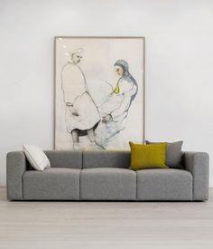 white wall; art; light floor; wooden floor; color combination