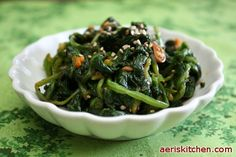 Korean:  Spicy Spinach MuChim:  spicy spinach side dish with red pepper paste and soybean paste.  From Aeri's Kitchen Website.