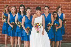 Blue #bridesmaid dresses and colorful #bouquets, photo by Carl Zoch Photography | via junebugweddings.com