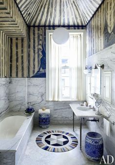 Lined with marble and painted decades ago to resemble a tent, the bath in this Philadelphia home decorated by Thomas Jayne is furnished with a Judi Boisson rug and antique Chinese garden stools. Tiny Bathrooms, Beautiful Bathrooms, Small Bathroom, Marble Bathrooms, Bathroom Ideas, Architectural Digest, Bad Inspiration, Bathroom Inspiration, Striped Room