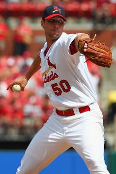 Adam Wainwright Photos - Starter Adam Wainwright of the St. Louis Cardinals pitches against the Kansas City Royals at Busch Stadium on June 2012 in St. The Royals beat the Cardinals in 15 innings. - Kansas City Royals v St Louis Cardinals St Louis Baseball, St Louis Cardinals Baseball, Baseball Tops, Stl Cardinals, Baseball Photos, Baseball Players, Nfl Football, Mlb Players, Baseball Games Online