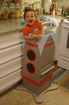DIY learning tower for the kitchen. If we build one of these, it's going to come with a removeable top with cage bars.