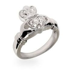Claddagh ... traditional Irish ring given as a token of friendship, love and/or as a wedding ring.  The elements of this   symbol are often said to correspond to the qualities of love (the heart), friendship (the hands), and loyalty (the crown).  The way that a Claddagh ring is worn on the hand is usually intended to convey the wearer's relationship status.