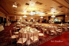 The Ballroom at Church Street Photos, Ceremony & Reception Venue Pictures, Florida - see they dont have that many flowers on the tables