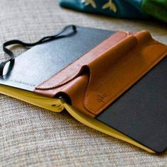 The Large Single Pen Quiver solves a notebook users most annoying problem, not having a pen available when you need it. Single Pen Quivers slide over almost any standard large notebook cover, front an Leather Art, Leather Books, Custom Leather, Leather Tooling, Brown Leather, Leather Book Covers, Leather Cover, Leather Notebook, Leather Journal