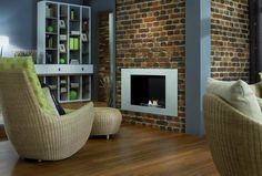 Relájate frente a la chimenea, enmarcada en ladrillo. Be relaxed in front of your chimney, next to the brick wall panels. Brick Wall Paneling, Bean Bag Chair, Relax, Interior, Living Rooms, Furniture, Home Decor, Brick, Walls