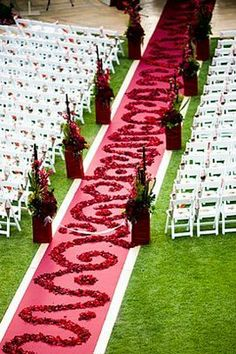 Gorgeous idea for aisle at an outdoor ceremony. Flower petals in henna-ish designs.