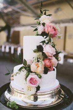 White Fondant Cake With Flowers | Brides.com