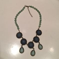 Statement necklace Never worn! Blue/Gary & Green stone necklace. Never worn. No tags! Jewelry Necklaces
