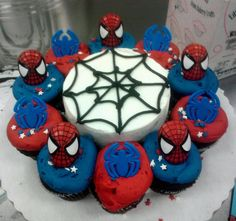 Spiderman Cake, cute and easy.  Make cupcakes, use rings from cake supply shop and star spinkles to decorate cupcakes, place around round cake with easy web design.