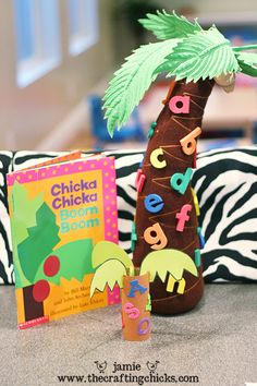 "Craft activity to go along with the children's book ""Chicka Chicka Boom Boom"". Create a coconut tree and add letters to the tree as you learn them."