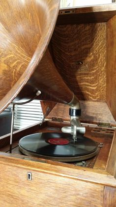 "Quartered Oak School House Victrola phonograph with oak horn. Circa 1920. Dimensions: 58""H x 27""W x 22""D. Average price (unfortunately) is in the $4000-$7500 range. :-\ Still, would love to have one of these. Twelfth Night, Phonograph, Color Themes, Get One, Caramel, Sink, Music Boxes, Musical, Antiques"