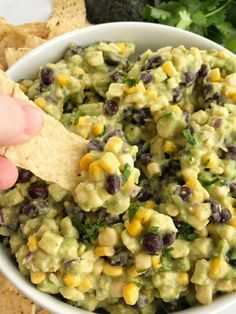 Avocado dip is packed full with chunky avocados, corn, black beans, red onion and then drizzled with easy & convenient canned salsa verde. So much flavor with very little effort. Avocado dip is the best game day appetizer, chip dip, and party food.  pictures & recipe updated January 2017 If you're here for this crazy good avocado dip then don't worry, you are still in the right place! This avocado dip has been crazy popular since posting it. I can see why too! It's creamy, the perfect party…