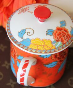 This orange peony flower bone china cup with a lid is full of bright colors and happy. The peony decoration is a symbol of marital happiness, riches and honor. From ZWZHome