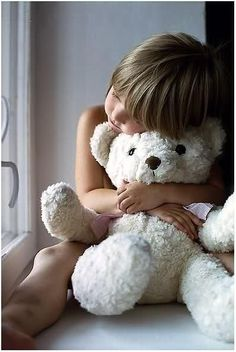 girl and her teddy bear