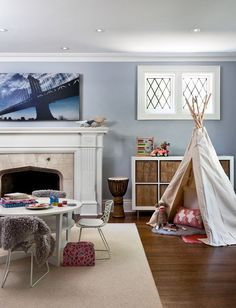 Jules's teepee in the loft, comfey rug and kid sized activity table