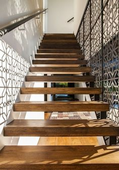 Design by the Details: Fretwork. The design on one side of the staircase creates a beautiful shadow on the wall. #homedecor #staircase #design