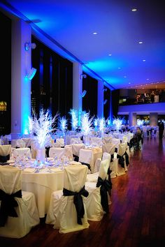 This picture was taken at The State Room, inside the State St building in Boston Massachusetts. The bride and groom celebrated their wedding day in a winter theme that included elegant light up snow centerpieces, a glowing blue cocktail bar, ambient lighting and a custom wishing tree