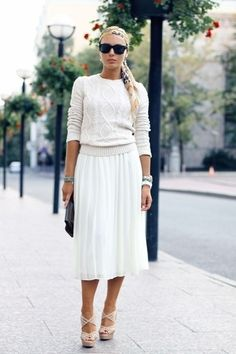White knit sweater with white pleated skirt