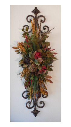 Silk floral arrangement made onto a metal sonic