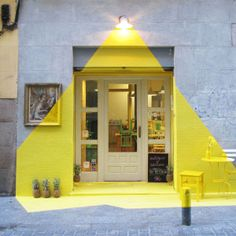 A restaurant's façade gets a bright makeover that plays with perspective and tricks the eye into thinking it's an actual beam of light shining down.