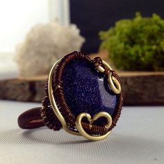 Blue goldstone copper brass ring by momentsinbeauty on Etsy  Starry night sky view in this beautiful , faceted blue goldstone ring. Wrapped with love in copper and brass..   Size 9  copper, brass, ring, statement ring, galaxy, cocktail ring, blue, stars, starry night, jewelry, rings, handmade jewelry, etsy, wire wrapping