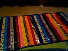 Duct Tape-Rug: Get an old towel or rug and layer with the duct tape colors of your choice!