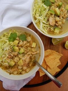 Chicken Pozole Verde: shredded chicken, hominy, salsa verde. Optional toppings: lime, cabbage, tortilla chips, radish, avocado.