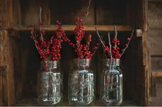 red berries in mason jars + babies breath