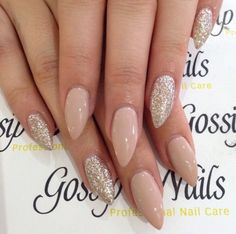 Nude stiletto nails with glitter