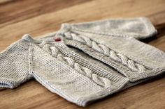 One of my favorite baby knitting patterns. Precious. Available for free at Knitting Daily, but you can also find it on Ravelry.