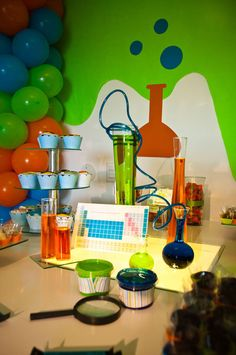 """Decorations for """"the lab"""" agency d3 VBX. Use vases & colored water?"""