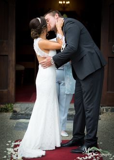 First kiss by bride and groom as husband and wife - wedding at Inglewood Estate