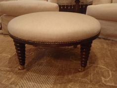 Ottoman....easy to top an old round coffee table with upholstered plywood and burlap. Needs a button tuft