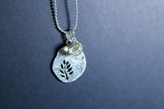 Resin and moss charm necklace https://www.etsy.com/listing/228430243/real-moss-sphere-and-silver-charm