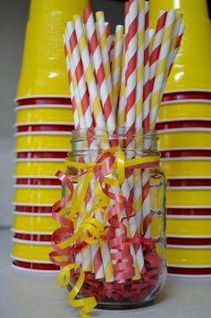 Cute way to display cups and straws for a Curious George Birthday Party