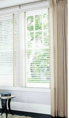 Hard treatments; Some just luv their windows & don't want to cover them. But consider, do u need to block the sun from glare? i.e; flat screen TV? Privacy & do you need the added insulation that blinds can provide.Using 2″ white wood blinds shown to the left can b functional and disappear. They relate to the window casings allowing the soft window treatments or room decor to become the focal point. Find them at BudgetBlinds.com