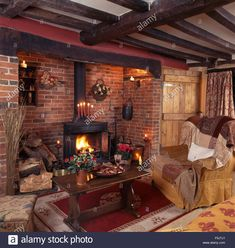 Stock Photo - Wood burning stove in inglenook fireplace in a beamed nineties country living room with an oak coffee table beside an armchair Country Lounge, Cottage Lounge, Cottage Living Rooms, Country Living, Country Style, Inglenook Fireplace, Cozy Fireplace, Fireplace Design, Fireplaces