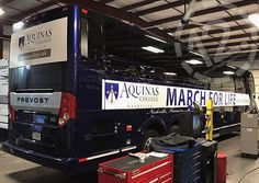 Custom graphics on a Prevost bus for Aquinas College in Nashville TN. 12-Point SignWorks - Franklin TN