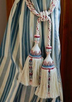 I like both the curtain and the tassels.