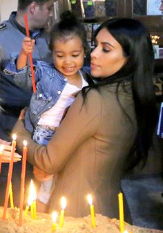 Kim & Nori lighting a candle in Armenia [March 2015] The majority of Armenians are Christian Orthodox