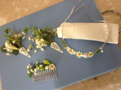 Corsages with silver filigree holders together with child's flower hair band and bridal comb. Contact Mary for your special flower requests.