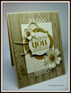 handmade card from stamping up north ... kraft and vanilla ... collage look with lots of adornments ... twine, buttons and die cut lacy panel ... woodgrain background  ... layered tag with the sentiment ... great card!