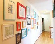 Map wall?  Love the colored frames, would be good accent colors for the aqua wall!