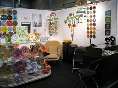Higgins Glass at the Chicago Mod Show. Mobiles, Rondelay Screens, Jewlery, Plates, Bowls and Sculptures.
