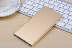 Gold Slab high power portable charger! Never run out of battery again! The Gold Slab charges two devices at ones and is compatible with android, iOS and comes with free metallic cables for both!
